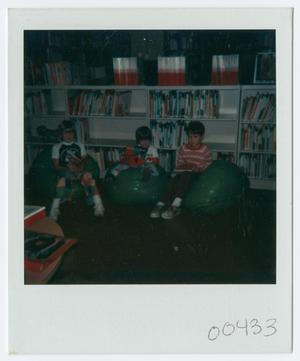 Primary view of object titled '[Children Reading at Helen Hall Library]'.