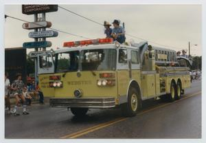 Primary view of object titled '[Yellow Fire Truck in a Parade]'.