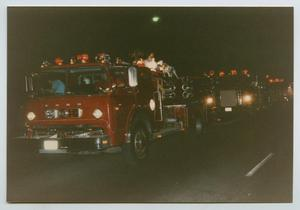 [Fire Trucks in a Holiday Parade]