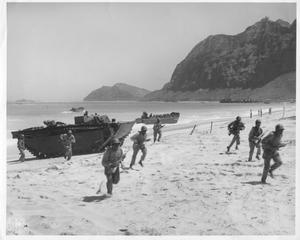 Primary view of object titled 'Troops Advancing During Beechhead Landing Maneuvers on Oahu in WWII'.
