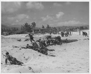 Primary view of object titled 'Troops Crawling Forward During Beachhead Landing Maneuvers on Oahu in WWII'.