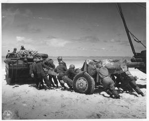 Primary view of object titled 'Troops Attaching a Howitzer to An Amphibious Vehicle During WWII Maneuvers on Oahu'.