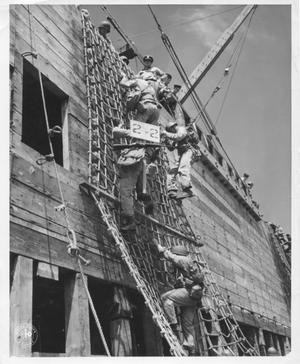 Primary view of object titled 'Troops Climbing Rope Ladder During Maneuvers in WWII'.