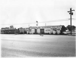 Primary view of object titled 'Kuykendall Tire Company and Howdy Doody Bass Grocery'.