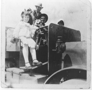 Primary view of object titled 'Visitors and a Soldier on a Military Vehicle at Camp Bowie'.