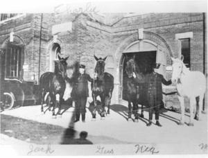 Primary view of object titled 'Two Firemen with Four Horses in Front of Their Station'.
