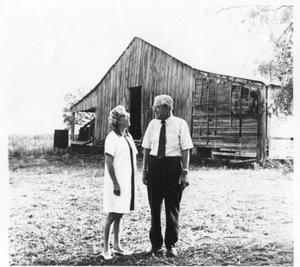 Primary view of object titled 'Searcy and Polly Dobkins at a Feed Mill'.