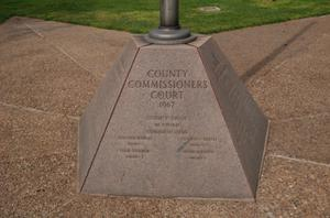 Primary view of object titled 'Fayette County Courthouse grounds, La Grange, base of light post'.