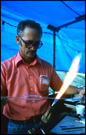 Primary view of object titled '[Joe Pyle Demonstrating Glass Crafting]'.