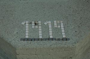 Primary view of object titled 'St. John the Baptist Catholic Church, detail of tile date'.