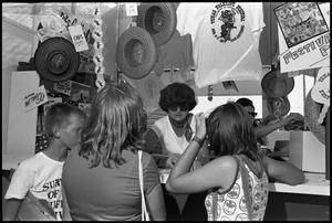 Primary view of object titled '[Woman Helping Visitors at Souvenir and Information Booth]'.
