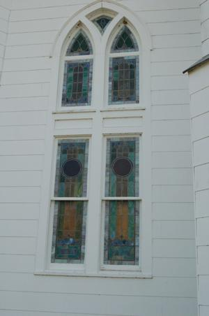 Primary view of object titled 'St. John the Baptist Catholic Church, detail of arched window'.