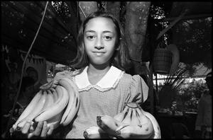Primary view of object titled '[Girl Holding Bananas]'.