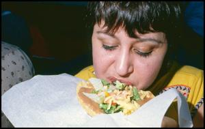 Primary view of object titled '[Woman Eating a Chalupa]'.