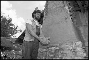 Primary view of object titled '[Man Constructing a Chimney]'.