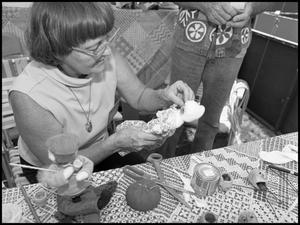 Primary view of object titled '[Woman Making Apple Dolls]'.