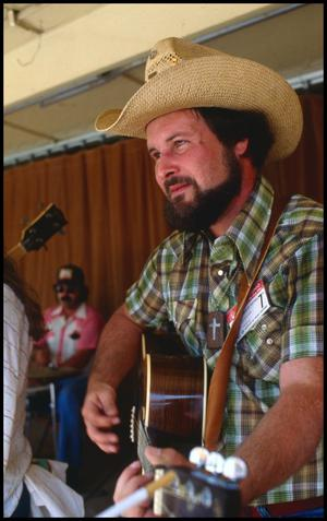 Primary view of object titled '[Lee McCullough Performing in A Luckenbach Afternoon]'.