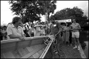 Primary view of object titled '[Rick and Cameron Pratt at the Texas Folklife Festival]'.