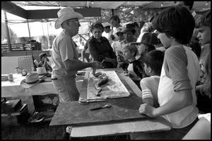 Primary view of object titled '[Snake Skinning at the Texas Folklife Festival]'.