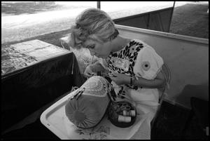 Primary view of object titled '[Graciela Wilborn Embroidering a Pillow]'.