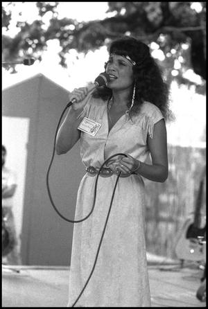 Primary view of object titled '[Marcia Breaz Performing at the Texas Folklife Festival]'.
