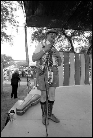 Primary view of object titled '[Bob Thornoff Performing at the Texas Folklife Festival]'.