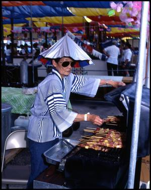 Primary view of object titled '[Sue Kosara Serving Yakitori]'.