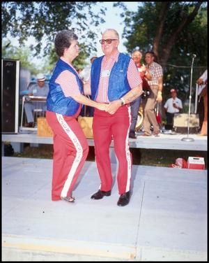 Primary view of object titled '[Mary and Jim Herbert Performing at the Texas Folklife Festival]'.