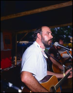 Primary view of object titled '[Gregg Cheser Performing at the Texas Folklife Festival]'.