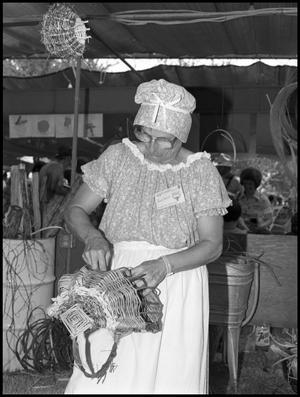 Primary view of object titled '[Goodie Di Raddo Making a Basket]'.