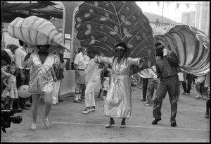 Primary view of object titled '[Carnival Parade at the Texas Folklife Festival]'.