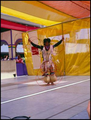 Primary view of object titled '[Alabama-Coushatta Dancer Performing with Rings]'.