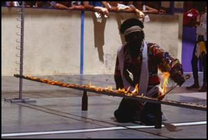 Primary view of object titled '[Man Lighting Fire Limbo Stick]'.