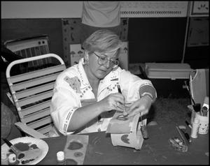 Primary view of object titled '[Margaret Rasnick Making a Stencil]'.