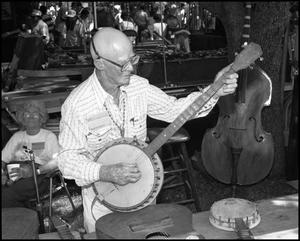 Primary view of object titled '[Bruce Roark Playing a Banjo]'.
