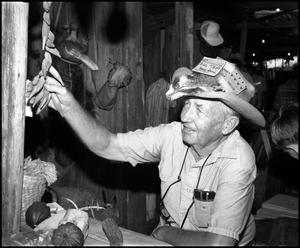 Primary view of object titled '[Bill Todd at Smokehouse]'.