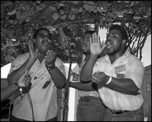 Primary view of object titled '[Men of the Voices of Zion Community Choir Singing and Clapping]'.