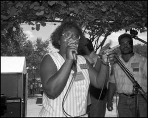 Primary view of object titled '[Female Member of the Voices of Zion Community Choir Performing]'.