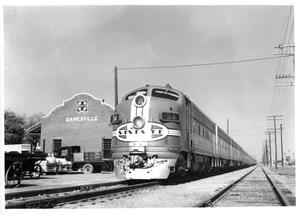 "Primary view of object titled '[""Texas Chief"" arriving at the Gainesville Depot]'."