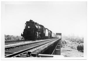 "Primary view of object titled '[""The Sunshine Special"" crossing the Trinity River Bridge]'."