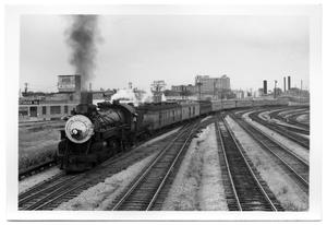 Primary view of object titled '[Southern Pacific locomotive arriving in Dallas]'.