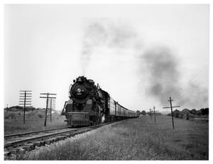 Primary view of object titled '[Locomotive rolls through Texas countyside]'.