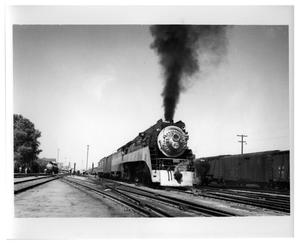 Primary view of object titled '[Locomotive departing from Tucson, Arizona]'.