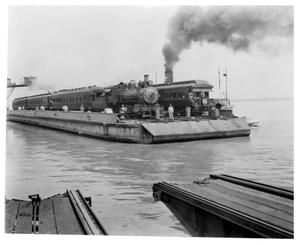 "Primary view of object titled '[Photograph of ""Sunset Limited"" crossing the Mississippi River]'."