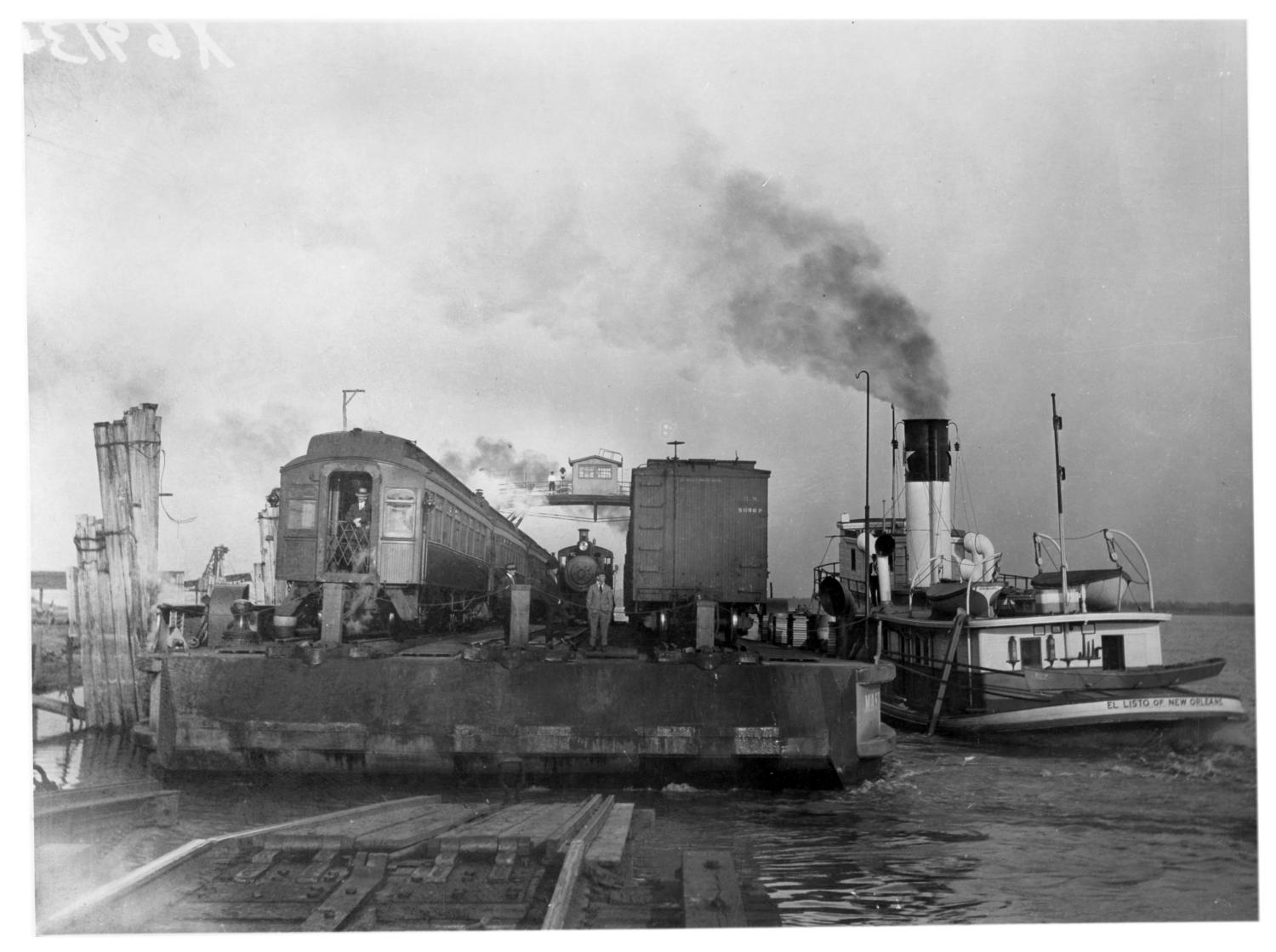[Ferry Barge and Passenger Train in New Orleans]                                                                                                      [Sequence #]: 1 of 1