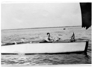 Buddy Sinclair in boat made by father 1938