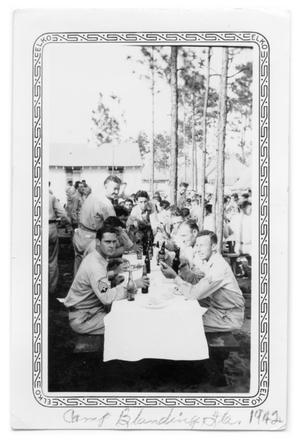 Primary view of object titled 'Soldiers at table in Camp Blanding 1942'.