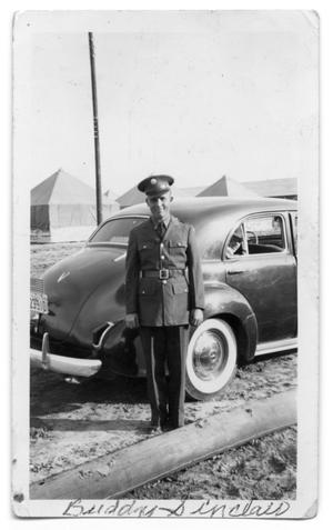 Primary view of object titled 'Buddy Sinclair standing in uniform outside car'.