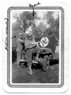 Primary view of object titled 'Two soldiers by jeep with weapons'.