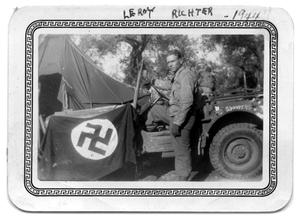 Primary view of object titled 'Soldier getting in jeep 1944'.